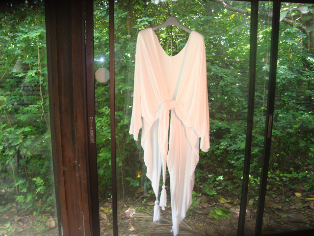 the picture is set in a garden setting and depicts a cotton garment in bright setting made in America