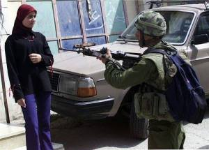 Woman from Palestine stands before an idiot coward IOF