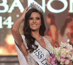 Sally Greige, 24, adjusts her crown after being crowned Miss Lebanon 2014 in Beirut on October 5, 2014. AFP PHOTO/ANWAR AMRO        (Photo credit should read ANWAR AMRO/AFP/Getty Images)